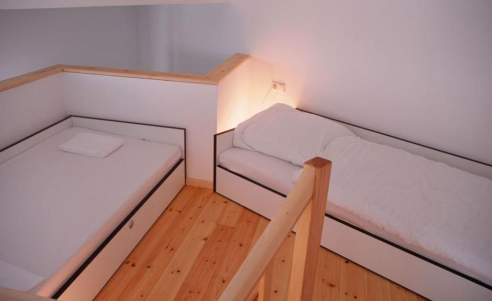 спальная в апартаментах GLS Berlin